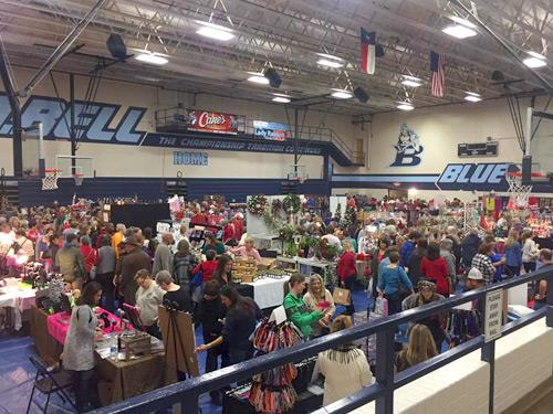 Bell High School gym completely full of craft fair booths, vendors, and shoppers