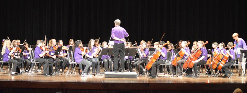 Elementary honor orchestra performing on stage